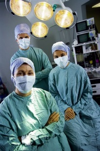 Three surgeons in a surgery suite