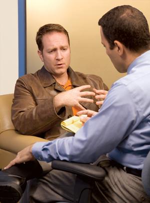 Man talking to therapist.