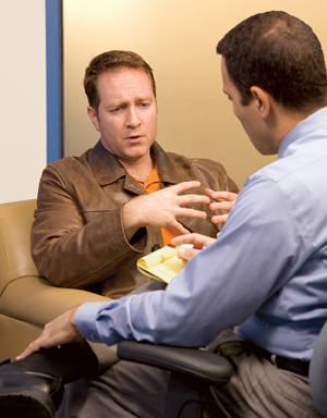 Man talking with healthcare provider.