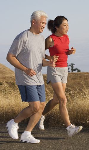 Mature couple jogging together.