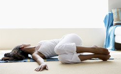 Woman performing exercise on the floor.