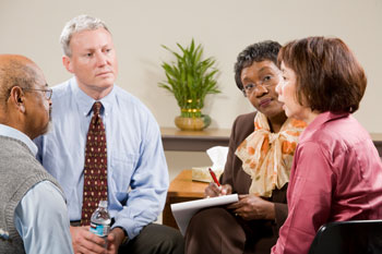 Woman talking with counselor and support group