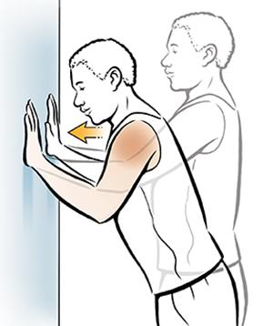 Man doing wall pushup shoulder exercise.
