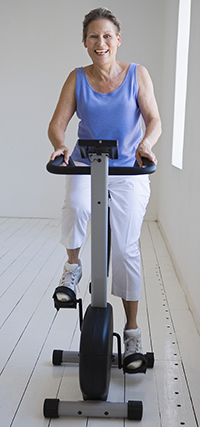 Woman on exercise bike.