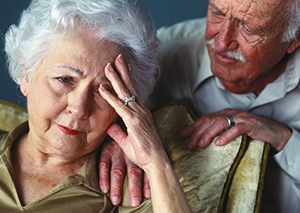 Man comforting woman.