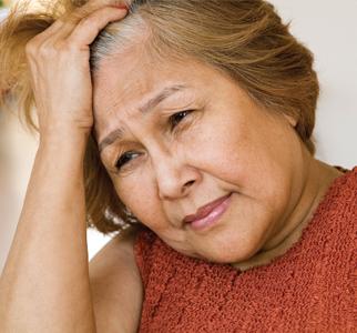 Older woman looking anxious