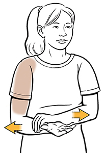 Woman doing isometric external rotation shoulder exercise.
