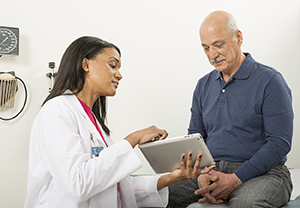 Healthcare provider talking to patient.
