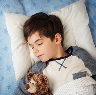 Child sleeping in his bed.