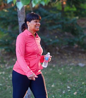 Woman walking in park.
