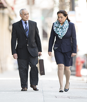 Man and woman in business clothes walking together.