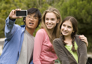 Teenagers taking a photo.
