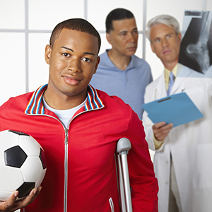 Young man with sports injury.