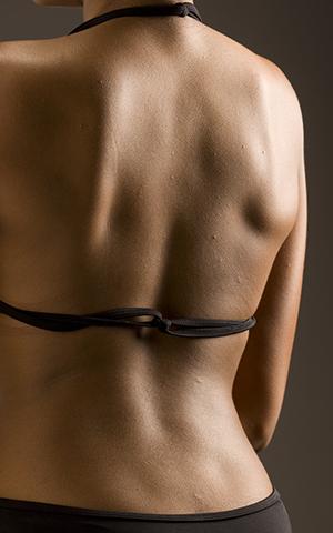 Closeup of female's back.