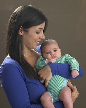 Mother holding infant.