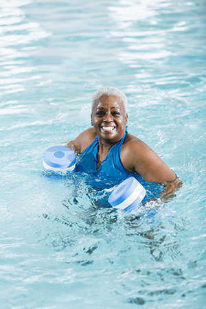 Woman exercising in pool.