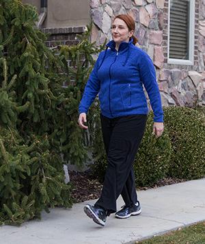 Woman walking outdoors.