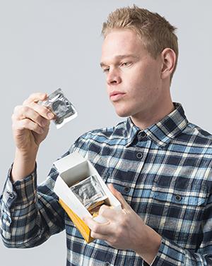 Man holding box of condoms.
