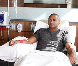 Man in outpatient clinic having chemotherapy infusion.
