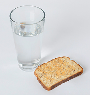 Glass of water and toast.