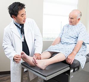 Doctor talking to patient in exam room.