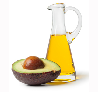 Half an avocado and a pitcher of olive oil