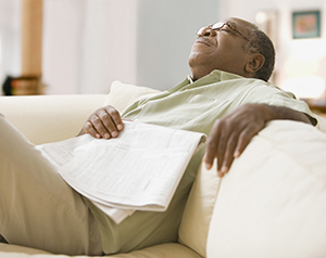 Man taking a nap on couch.