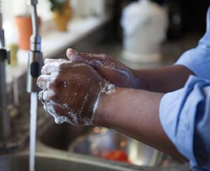 Closeup of handwashing in sink.
