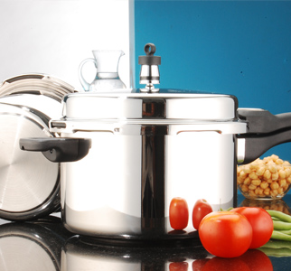 Pressure cooker and vegetables on a counter