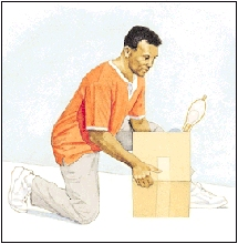 Image of man on one knee picking up a box