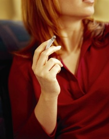Woman smoking a cigarette.