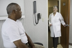 Older man and doctor in an exam room