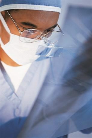 Surgeon looking at an x-ray