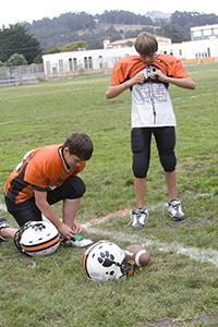 Boys dressing for football