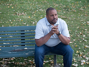Man sitting on park bench.