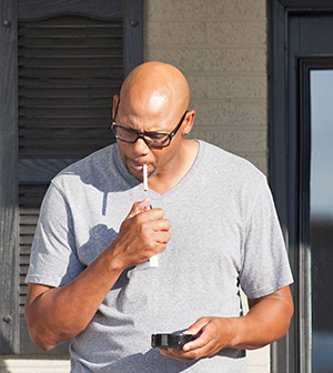 Man about to smoke a cigarette outdoors