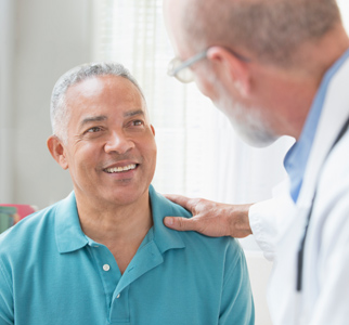 Doctor talking with man in exam room