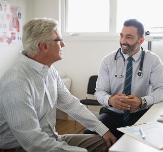 Male doctor talking with male patient
