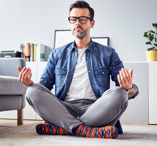 Man sitting on floor meditating