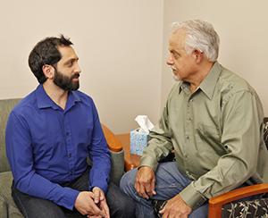 Man talking to mental health professional.