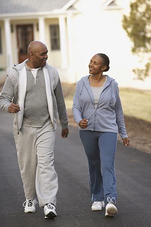 Older couple walking down a street.